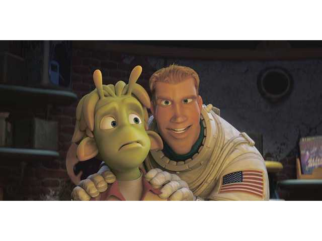 "The characters Lem, voiced by Justin Long, and Chuck Baker, voiced by Dwayne Johnson, right, are shown in a scene from the animated feature ""Planet 51,"" which opens locally this week."