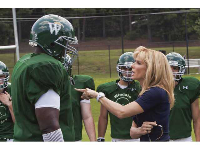 "Quint Aaron and Sandra Bullock are shown in a scene from, ""The Blind Side,"" which opens this week."