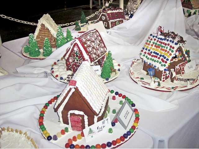 A gingerbread village of homemade gingerbread homes will be available for sale at the Festival of Trees.