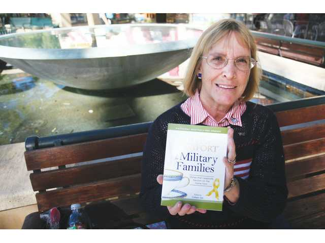 "Eileen Granfors contributed her story about growing up with a military father in the book titled ""A Cup of Comfort for Military Families."""