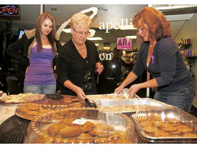 From left, Melissa Hathaway, Donna Blowey and Linda McNab sell their homemade treats outside Capelli Salon on Thursday during the Third Thursday Art Walk in Newhall.