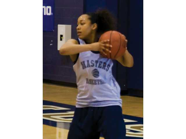 Erica Inge, starting point guard for The Master's College women's basketball team, handles the ball during Wednesday's practice at the Bross Gymnasium.