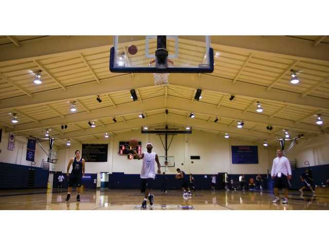 Members of The Master's College men's basketball team run through a drill during Wednesday's practice at Bross Gym.