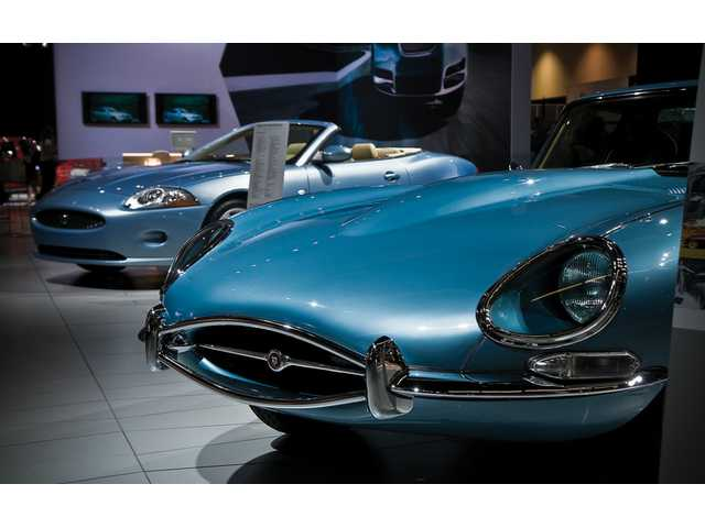 A classic Jaguar XK (foreground) lines up with its 2009 progeny (background) at the L.A. Auto Show.