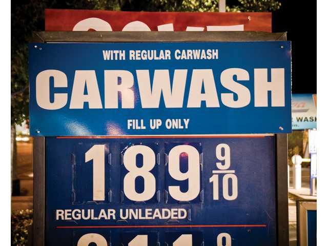 A sign at AutoSpa Car Wash and Chevron in Valencia advertises the price for a gallon of unleaded fuel with the purchase of a car wash Thursday.