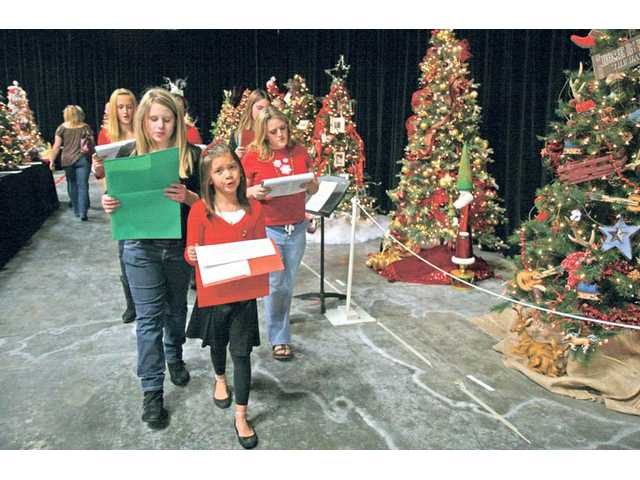 Participants in the Canyon Theatre Guild children's program walk around the Festival of Trees singing Christmas carols on Friday afternoon.
