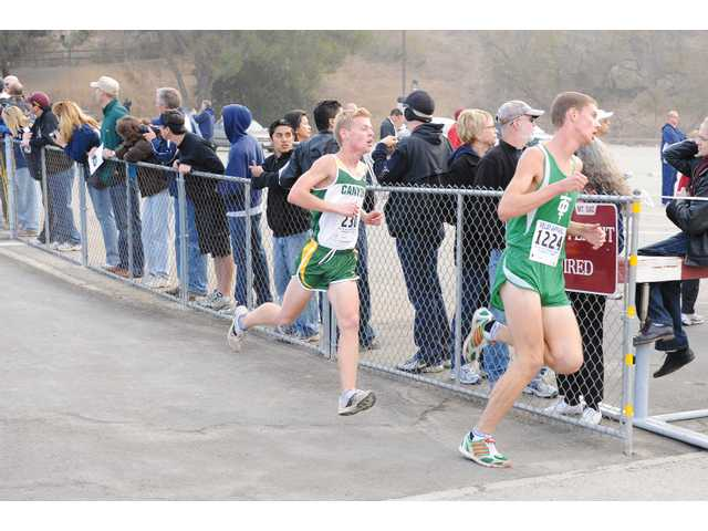 Canyon's Tommy McGuan, left, competes in the CIF-SS Division II final on Saturday.  All five Foothill League schools in the finals advanced to the CIF state meet in Fresno.