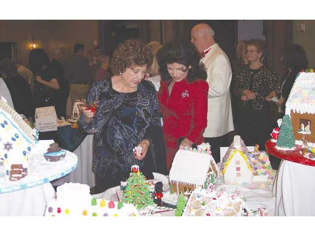 In addition to decorated trees, guests enjoyed the creative efforts given to dozens of gingerbread houses on display and for sale.