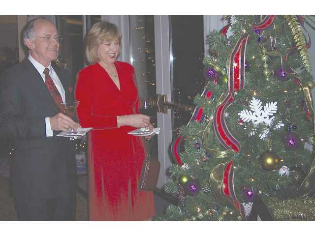 Bill and Cathy Kennedy enjoy one of the beautifully decorated trees at the sixth annual Festival of the Trees held to benefit the SCV Boys & Girls Club.