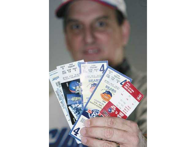Klymshyn displays a handful of ticket stubs from past New York Giants games.