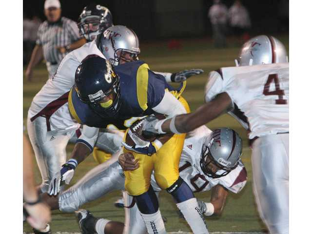 College of the Canyons running back Fred Winborn scores two touchdowns in the Cougars 41-17 win over the Marauders on Saturday night at Cougar Stadium. COC now turns their attention to El Camino College.