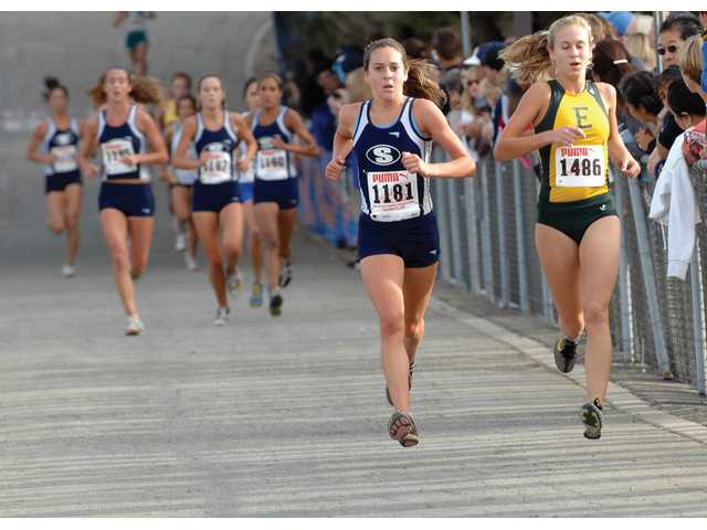 Kaylin Mahoney pulls away from the pack for the Centurions at the CIF-Southern Section Cross Country Championships Saturday at Mt. San Antonio College in Walnut. Mahoney is followed by Stephanie Bulder (back left), Amber Murakami (front left), Anne Randall (middle), and Brianna Jauregui (back right) for Saugus.