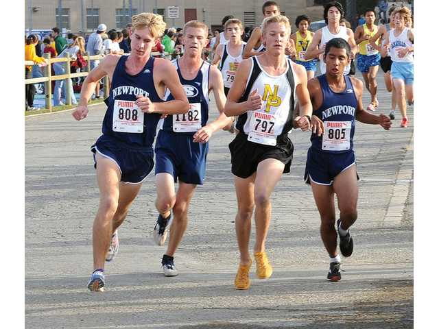 Saugus runner Camden McAlister, second from left, runs alongside Newport's Jake Dawson, left, Luke Klein of Newbury Park, third from left, and Newport's Trent Casillas on Saturday during the CIF-Southern Section Cross Country Championships at Mt. San Antonio College in Walnut.