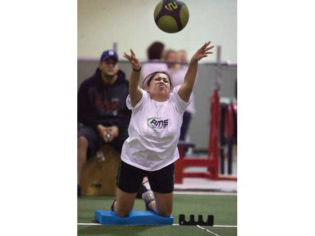 Zuleika Hernandez, member of the AMS team, takes part of the Powerball Throw event during the first Corporate Combine Challenge at Velocity Sports Performance Sunday afternoon.