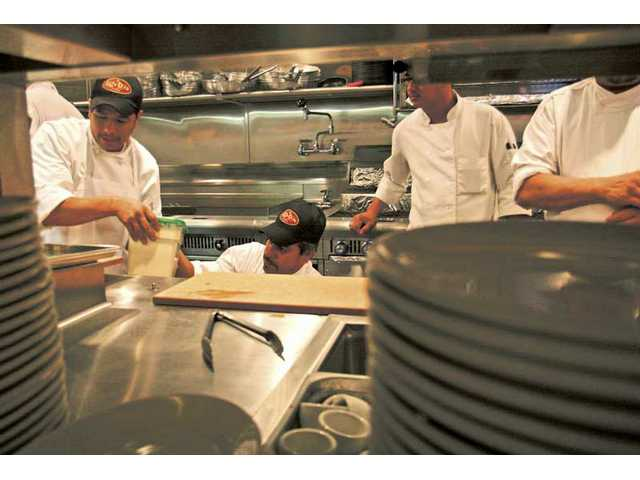 Lazy Dog chefs get to know the kitchen at the new restaurant location in The Patios at the Westfield Valencia Town Center.