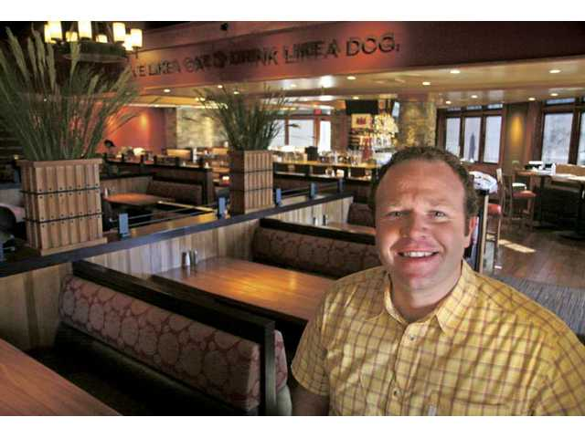 Chris Simms, CEO and founder of Lazy Dog restaurants, stands inside the newest location in The Patios at the Westfield Valencia Town Center.