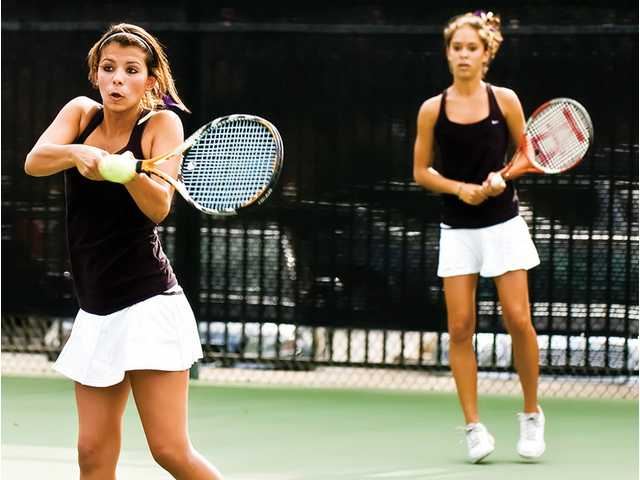 The Valencia Vikings' No. 1 doubles team of Amanda Jansson, left, and Emily Fraczek play in their first match Monday against the Valencia of Placentia Tigers in the CIF-Southern Section Division III Girls Team Tennis Finals at Claremont Club.  The Vikings lost the match 13-5.