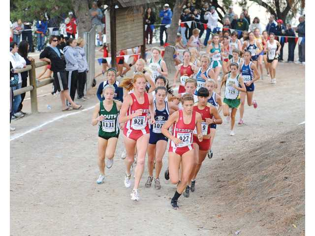 Saugus' Kaylin Mahoney, center, runs at the CIF-Southern Section Division II finals on Saturday at Mt. San Antonio College. Mahoney and the Centurions are going for their fourth consecutive CIF state title on Saturday in Fresno.