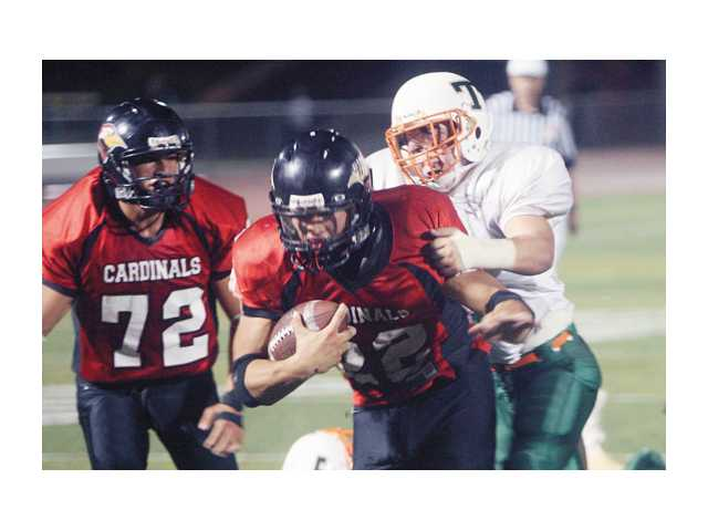 In a recent game against Thatcher, Santa Clarita Christian running back Collin Keoshian carries the football.
