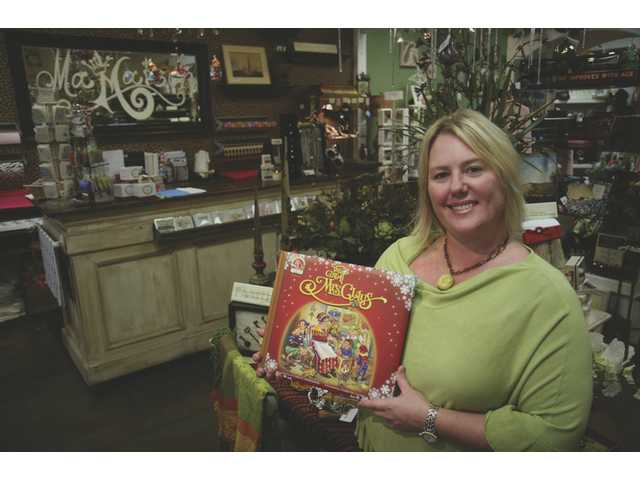 "Co-owner Ede Eichmann Holds a copy of the book titled ""The Great Mrs. Claus"" inside her Valencia Ma Maison gift shop. The store was formerly known as Madalian."