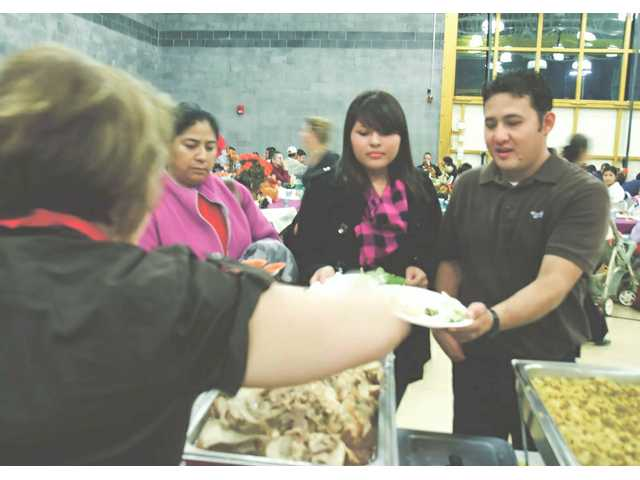 More than 400 people enjoyed a free Thanksgiving dinner at the Santa Clarita Community Center Tuesday.