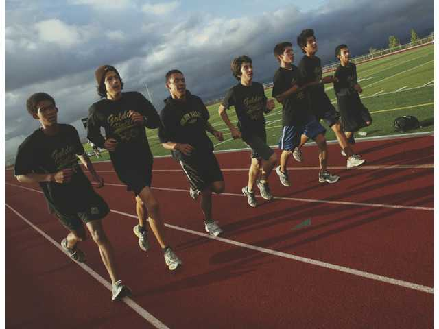 Members of the Golden Valley boys cross country team run during a practice Wednesday on the track at Golden Valley.