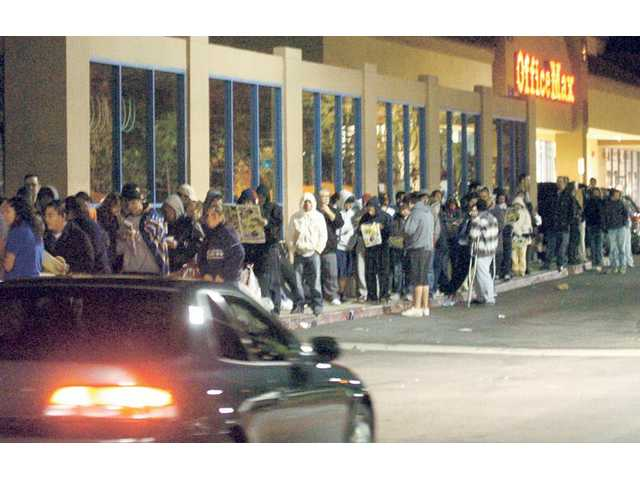 The line of Black Friday bargain hunters stretched half a block, from Best Buy to Office Max.