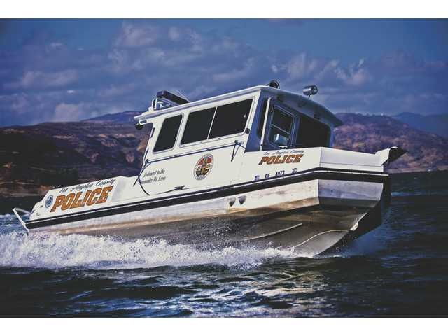 The Los Angeles County Police 26 ACB patrol boat patrols Castaic Lake on Thanksgiving. The police will receive another boat in the coming month.