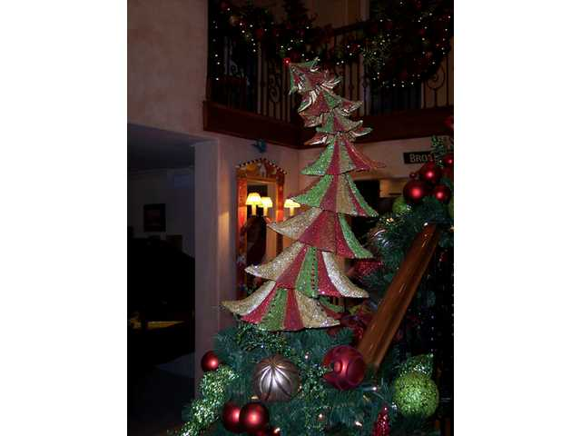 A whimsical tree graces the bannister of the staircase.
