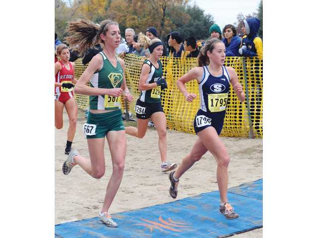 Saugus' Kaylin Mahoney, right, approaches the first hill of the course during the CIF State Division II cross country race on Saturday at Woodward Park in Fresno. Mahoney finished third and Saugus won its fourth consecutive CIF state championship.