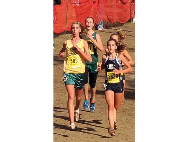 Saugus' Kaylin Mahoney, left, is pursued by Casa Grande's Jacque Taylor, right. Mahoney won the individual title with a time of 17:34 in Fresno.