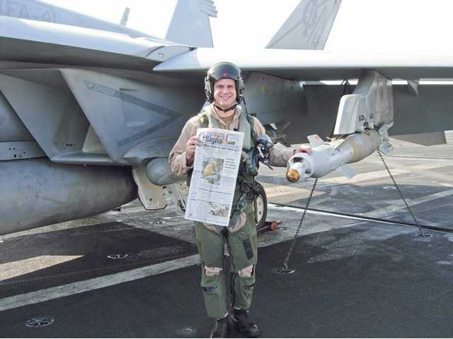 "Navy Lt. j.g. Kyle Terwilliger, a 2002 Hart graduate, took The Signal aboard the Nimitz Carrier with his F/A 18F Super Hornet in the VFA-41 ""Black Aces"" Strike Fighter Squadron. His squadron is on routine deployment involving action over Afghanistan."