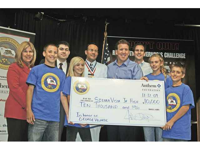 "From left to right: Santa Clarita City Councilwoman Laurie Ender, seventh-grader Alex McKenna, Bret Walter, representing U.S. Congressman Howard ""Buck"" McKeon, seventh-grader Hannah Taylor, George Velarde, teacher of the year, Jake Steinfeld, Assemblyman Cameron Smyth and seventh-graders Kendall Bietsch and Griffin Peters."