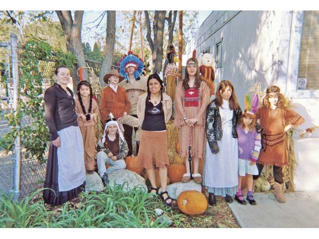 Monticello Prep School students celebrated their first Thanksgiving at their new campus on Valley Street in the Happy Valley community. Pictured in Pilgrim and Native American costumes are Trisha Curran, Yessinia Fuentes, Kendall Irvin, Sabrina Forbes, George Rosalar, Jenna Irvin, Alex Cranert, Laura Defalco, Christian Cranert and Jenny Cranert.