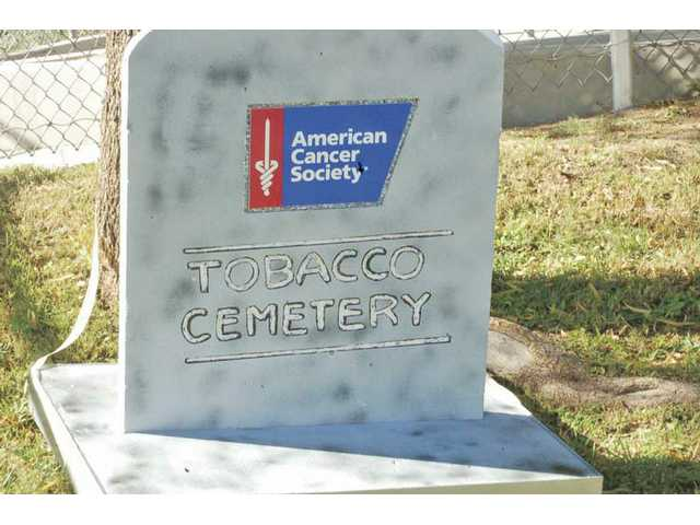 A tombstone from the tobacco cemetery notes the American Cancer Society, which sponsors the Smokeout.