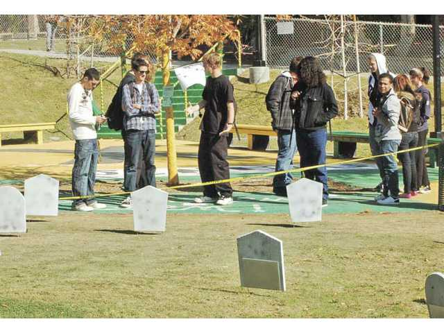 Canyon High School's chapter of the American Cancer Society, known as the Canyon Cancer Crushers, organized a tobacco cemetery on Nov. 19 to honor those who have died from tobacco-related illnesses as an effort to support the Great American Smokeout.