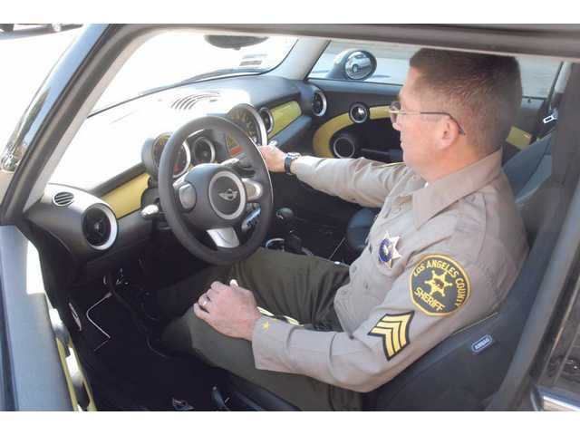 Because of its limited range and power, the electric mini is used only for administrative work, but it lets deputies help to lower vehicle emissions.