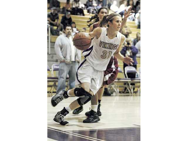 Valencia basketball player Lauren Spargo charges to the basket Tuesday at Valencia High.