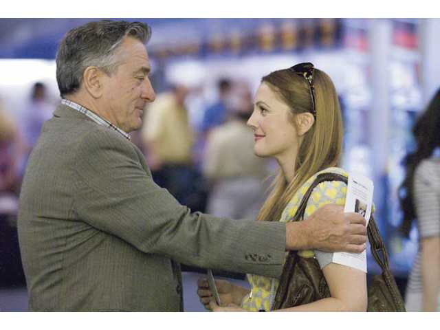 "Robert De Niro, left, and Drew Barrymore are shown in a scene from Miramax's ""Everybody's Fine."""
