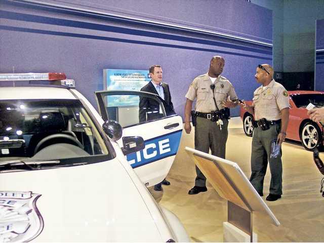 Los Angeles sheriff's deputies discuss Chevrolet's 2011 Caprice PPV (police patrol vehicle).