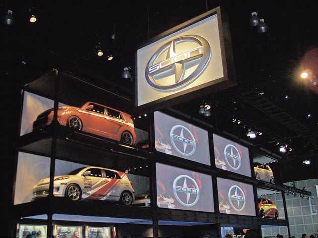 The Scion display at the 2009 L.A. Auto Show was among the more impressive efforts by the world's automobile manufacturers, which have turned down the volume this year and concentrated on exhibits of the affordable and fuel efficient cars that consumers want.