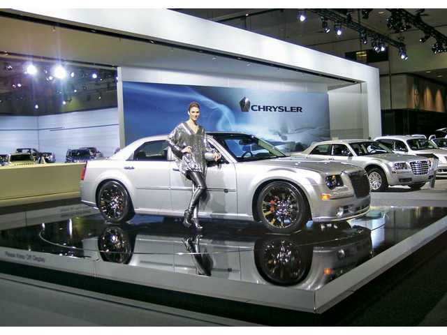 """At L.A. Auto Show press days there were more models on display than ever before, which gave the event an almost """"retro"""" feel. Chrysler's low key display fit in perfectly with its automotive peers this year."""