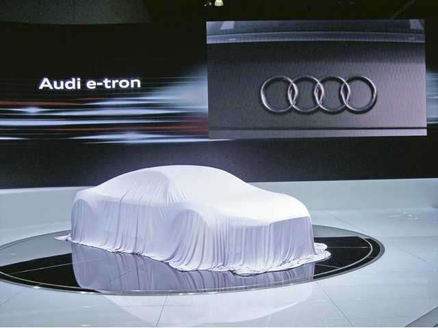 "The Audi e-tron concept vehicle awaits its ""reveal"" during press days at the L.A. Auto Show. The e-tron is a high-performance sports car with a purely electric drive system."