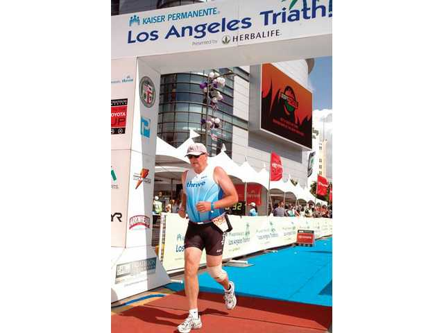 "Pilarski crosses the triathlon finish line ""not in last."""