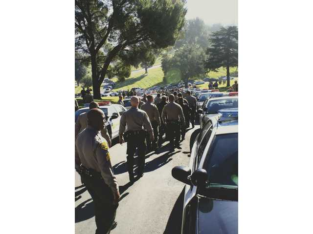 More than 200 people showed their respect for sheriff's Sgt. Archibald Henderson Jr. as the procession made its way to the Eternal Valley Memorial Park.