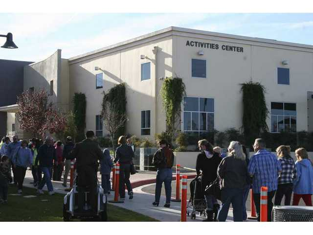 Local residents lined up outside the Santa Clarita Sports Complex Activities Center for free H1N1 flu shots Friday morning. Shots will be dispensed until 4 p.m., or all the doses are gone.