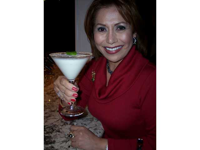 Lina Seaver toasts with a Winter Wonderland martini.
