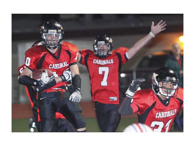 Russell Gage, left, Steven Borden (7) celebrate after beating Faith Baptist for a CIF 8-Man title.