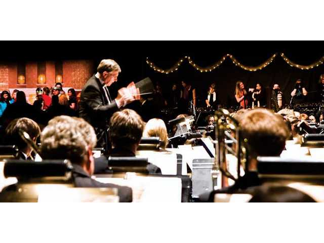 "Dr. Steven Opfer leads The Master's College orchestra during ""Come ChristmasSing"" Thursday at the school's Placerita Canyon campus."