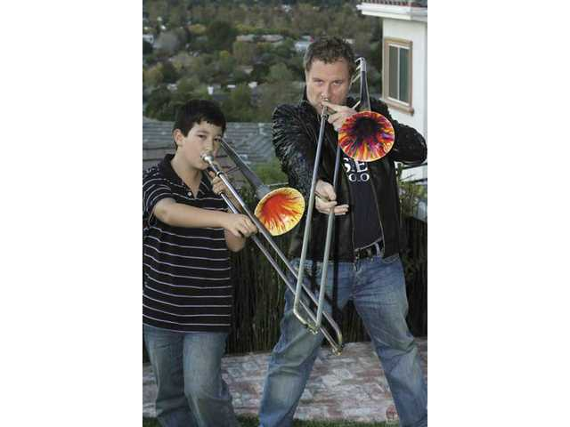 Jazz trombonist Jim Moseley jams with his son James and their home in Newhall. Jim Moseley has played with stars such as Frank Sinatra, John Lennon and Grover Washington Jr.